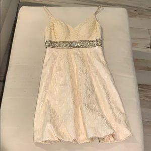 Rosy cream colored dress